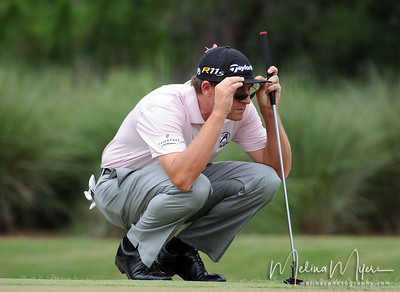 May 13, 2012; Ponte Vedra Beach, FL, USA; David Mathis lines up his putt on the 2nd hole during the fourth round of the PLAYERS Championship at TPC Sawgrass. Mandatory Credit: Melina Vastola-US PRESSWIRE