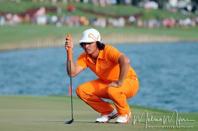 May 13, 2012; Ponte Vedra Beach, FL, USA; Rickie Fowler lines up his putt on the 18th hole during the the PLAYERS Championship at TPC Sawgrass. Mandatory Credit: Melina Vastola-US PRESSWIRE