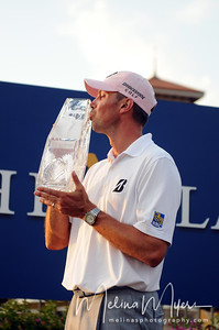 May 13, 2012; Ponte Vedra Beach, FL, USA; Matt Kuchar kisses his trophy after winning the the PLAYERS Championship at TPC Sawgrass. Mandatory Credit: Melina Vastola-US PRESSWIRE