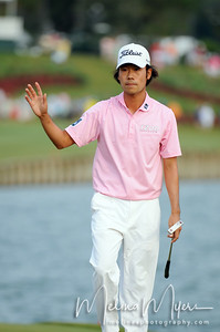 May 13, 2012; Ponte Vedra Beach, FL, USA; Kevin Na acknowldeges the crowd on the 18th hole during the the PLAYERS Championship at TPC Sawgrass. Mandatory Credit: Melina Vastola-US PRESSWIRE