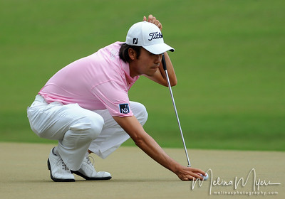 May 13, 2012; Ponte Vedra Beach, FL, USA; Kevin Na lines up his putt on the 3rd hole during the fourth round of the PLAYERS Championship at TPC Sawgrass. Mandatory Credit: Melina Vastola-US PRESSWIRE