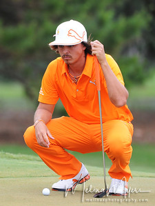 May 13, 2012; Ponte Vedra Beach, FL, USA; Rickie Fowler lines up his putt on the 2nd hole during the fourth round of the PLAYERS Championship at TPC Sawgrass. Mandatory Credit: Melina Vastola-US PRESSWIRE