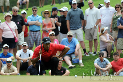May 13, 2012; Ponte Vedra Beach, FL, USA; Tiger Woods lines up his putt on the 3rd hole during the fourth round of the PLAYERS Championship at TPC Sawgrass. Mandatory Credit: Melina Vastola-US PRESSWIRE