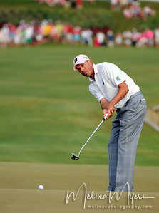 May 13, 2012; Ponte Vedra Beach, FL, USA; Matt Kuchar putts the ball on the 18th hole during the the PLAYERS Championship at TPC Sawgrass. Mandatory Credit: Melina Vastola-US PRESSWIRE
