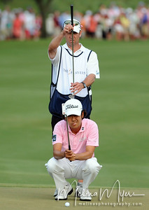 May 13, 2012; Ponte Vedra Beach, FL, USA; Kevin Na lines up his shot on the 18th hole during the the PLAYERS Championship at TPC Sawgrass. Mandatory Credit: Melina Vastola-US PRESSWIRE
