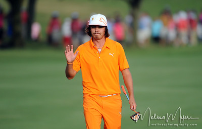 May 13, 2012; Ponte Vedra Beach, FL, USA; Rickie Fowler acknowledges the crowd on the 18th hole during the the PLAYERS Championship at TPC Sawgrass. Mandatory Credit: Melina Vastola-US PRESSWIRE