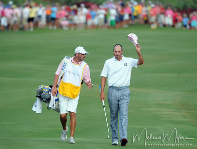 May 13, 2012; Ponte Vedra Beach, FL, USA; Matt Kuchar acknowldeges the crowd on the 18th hole during the the PLAYERS Championship at TPC Sawgrass. Mandatory Credit: Melina Vastola-US PRESSWIRE