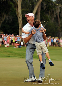 May 13, 2012; Ponte Vedra Beach, FL, USA; Matt Kuchar celebrates with his son after winning the the PLAYERS Championship at TPC Sawgrass. Mandatory Credit: Melina Vastola-US PRESSWIRE
