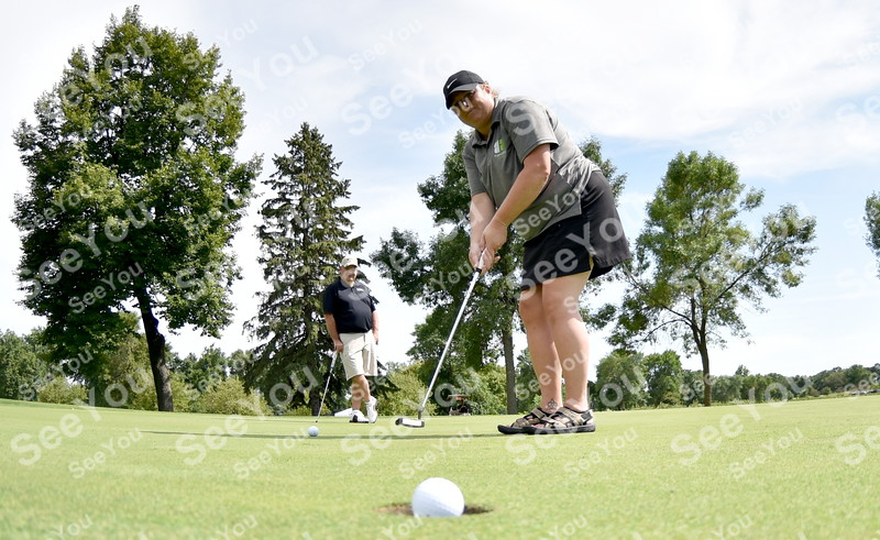 -Messenger photo by Britt Kudla<br /> Molly Schaeffer of Fort Dodge chip a birdie during Greater Growth Alliance tournament on Thursday