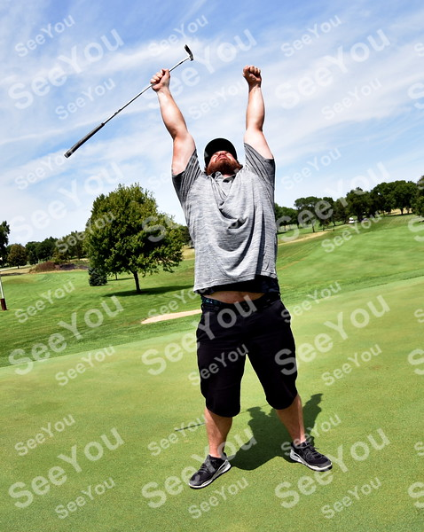 -Messenger photo by Britt Kudla<br /> Leo Stucky of Fort Dodge react after a putt during Greater Growth Alliance on Thursday at Fort Dodge Country Club