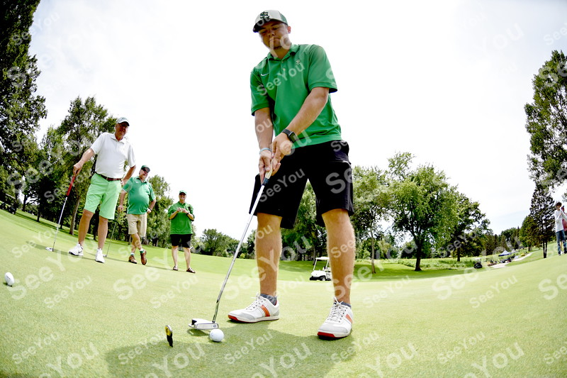 -Messenger photo by Britt Kudla<br /> Nick Clark of St. Edmond putts during Greater Growth Alliance tournament on Thursday at Fort Dodge Country Club