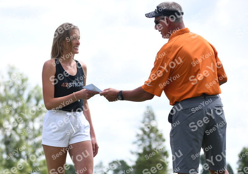 -Messenger photo by Britt Kudla<br /> Cambrie McBride of St. Edmond receive scholarship from the Huss family during 42 Strong annual golf tournament on Friday at Lakeside golf course