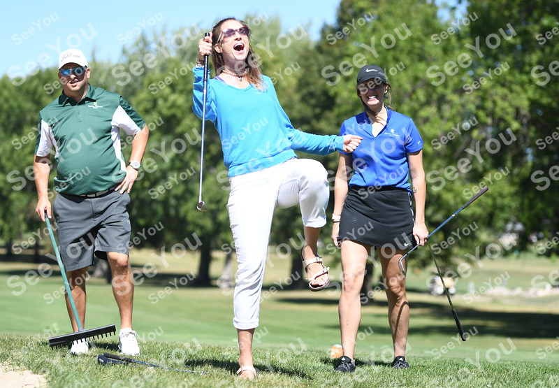 -Messenger photo by Britt Kudla<br /> Molly Nelson of Fort Dodge react to a shot during Greater Growth Alliance Tournament on Thursday at Fort Dodge Country Club