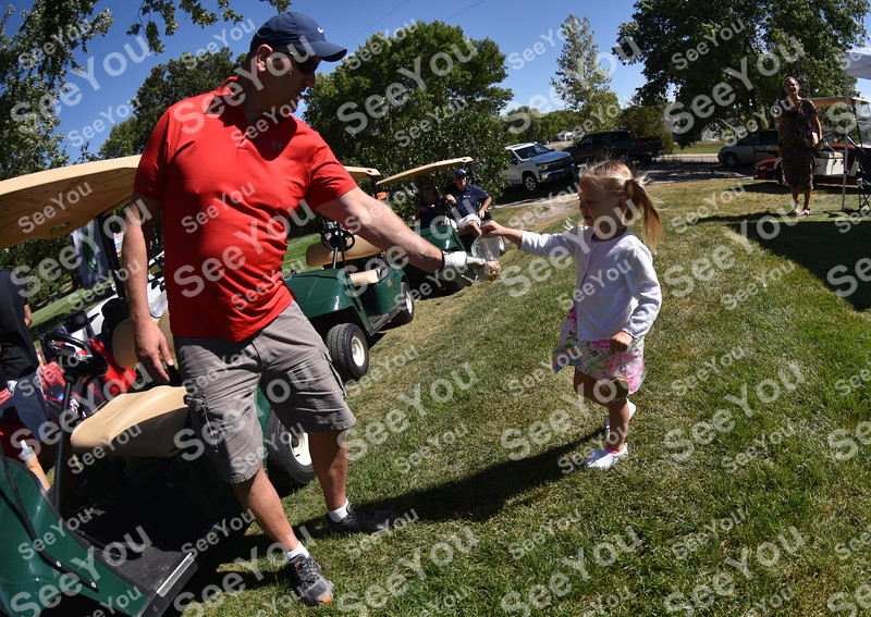 -Messenger photo by Britt Kudla<br /> Isabella Johnson of Fort Dodge hands out cookies to golfers-during  Greater Growth Alliance Tournament on Thursday at Fort Dodge Country Club