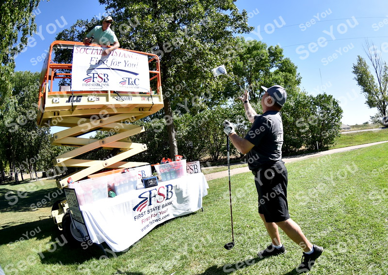 -Messenger photo by Britt Kudla<br /> David Taylor of First State Bank practice social distancing  during  Greater Growth Alliance Tournament on Thursday at Fort Dodge Country Club