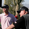 Butch Harmon listens to some free advicefrom a fan.