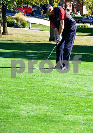 -Messenger photo by Britt Kudla<br /> Kevin Hinz of Cedar Rapids drives the ball onto the green during Saturday's golf tournament