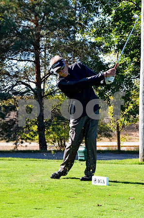 -Messenger photo by Britt Kudla<br /> Terry Miller of Fort Dodge tees off during Saturday golf tournament on Saturday at the Fort Dodge country club