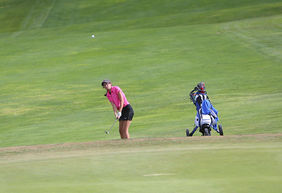 Gering's Jaylen Beam chips onto the green during class B district golf in Sidney.