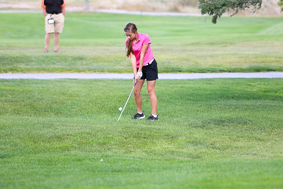 Gering's Megan Maser chips onto the green  during class B district golf in Sidney.