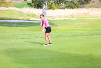 Gering's Megan Maser hits her putt during class B district golf in Sidney.