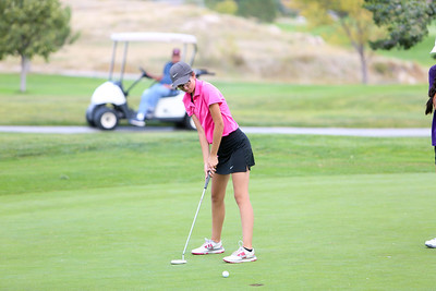 Gering's Jaylen Beam hits her putt during class B district golf in Sidney.