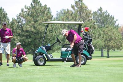 Team Fisher Roofing - Dave Knutson golfing, L-R Ryan Knutson, Scott Butler, ,