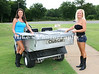 Ginger Robers (Fayetteville) Daba Mayfield (LR) fver drinks during the Harbor Oaks 4-Ball Golf Tournament in Pine Bluff
