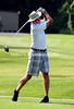 Andy Speir drives off the 1st Tee Saturday at the Harbor Oaks Mixed Invitational. /Mike Adam