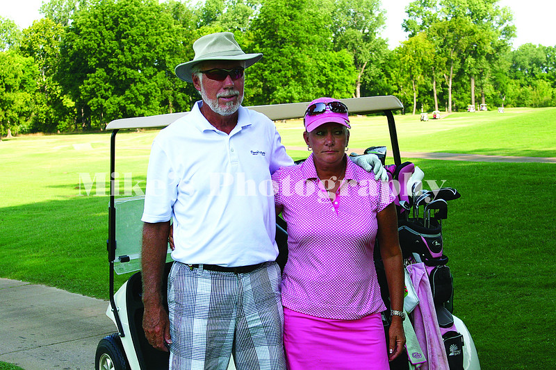 Andy and Katie Speir stop for a picture before hitting the 1st tee at the Habor Oaks Mixed Invitational Saturday. /Mike Adam