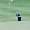Leta Lindley of Palm Beach Gardens, Florida puts her approach right on the flag ...