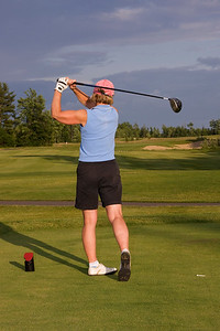 Diane in follow through after driving golf ball (MURR3667)