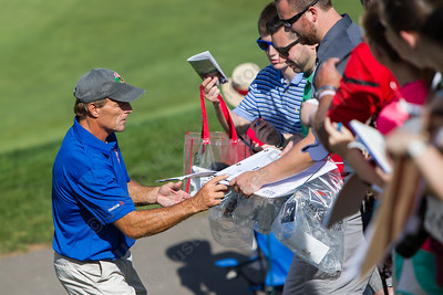 Doug Flutie takes time to sign autographs between holes Wednesday during the Travelers Championship Pro-Am at TPC River Highland in Cromwell Jun. 24, 2015 | Justin Weekes / For the Record-Journal
