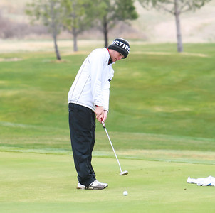Scottsbluff's Andrew Holloway putts at the Sidney Invite on Thursday at the Hillside Golf Course in Sidney.