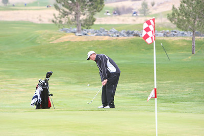 Scottsbluff's Michael Hadden chips onto the green at the Sidney Invite on Thursday at the Hillside Golf Course in Sidney.