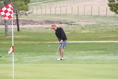 Ogallala's Shad Krajewski chips onto the green at the Sidney Invite on Thursday at the Hillside Golf Course in Sidney.