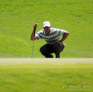 Tiger Woods lines up his shot at the1st hole of the 2009 The Players held May 4-10 in Ponte Vedra Beach, Florida.