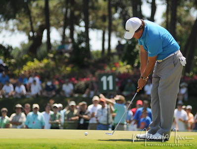 Phil Mickelson makes a putt at the 11th hole of the 2009 The Players held May 4-10 in Ponte Vedra Beach, Florida.