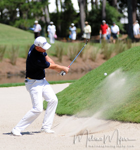 Matt Kuchar chips the ball out of the bunker at the 11th hole of the 2009 The Players held May 4-10 in Ponte Vedra Beach, Florida.