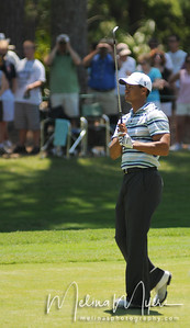 Tiger Woods watches his shot from the fairway of the 1st hole at the 2009 The Players held May 4-10 in Ponte Vedra Beach, Florida.