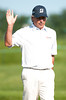 July 12, 2012; Lake Orion, MI, USA; Fred Couples (USA) waves to the crowd after making his putt on the 10th green during the first round of the U.S. Senior Open at Indianwood Golf and Country Club. Mandatory Credit: Tim Fuller-US PRESSWIRE