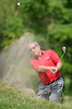 July 14, 2012; Lake Orion, MI, USA; Fuzzy Zoeller (USA) hits of a bunker on the 13th green during the third round of the U.S. Senior Open at Indianwood Golf and Country Club. Mandatory Credit: Tim Fuller-US PRESSWIRE