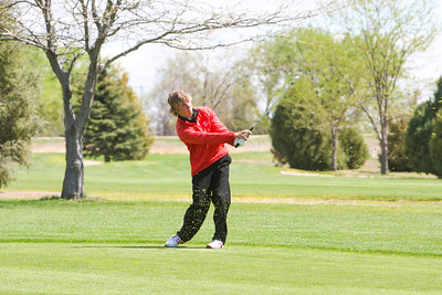 Kimball's Jeff Greenwood chips onto number eight hole at the Western Trails Conference Tournament at Bayard on Saturday.