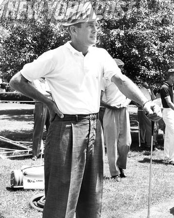 Jay Hebert Admires Golf Ball Flying Through The Air. 1959