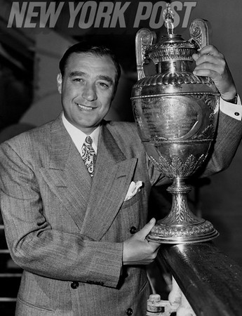 Willie Turnesa showing off his 1947 British Amateur Championship trophy. 1947