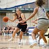 Indiana Tech Warriors guard Emma Touminen (3) dribbles the ball in toward the basket against Goshen Maple Leafs forward Graysen Cockerham Jr. (4) during Friday's game at Goshen College in Goshen.
