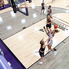 Goshen Maple Leafs forward Graysen Cockerham Jr. (4) goes up for a basket against Indiana Tech Warriors guard Emma Tuominen (3) during Friday's game at Goshen College in Goshen.