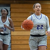Goshen Maple Leafs guard Mariah Roe (22) dribbles the ball down court during Friday's game at Goshen College in Goshen.