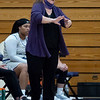 Goshen Maple Leafs head coach Stephanie Miller communicates with her players during Friday's game at Goshen College in Goshen.