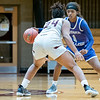 Goshen College guard Janara Flowers (1) dribbles the ball down court against Holy Cross College forward Jaliah Nailor (24) during Wednesday's game at Holy Cross College in South Bend.